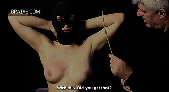 Big titty girl must not budge while she is caned